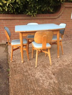 Blue Danish Formica table & four chairs with ball feet