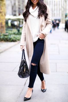 Ripped skinny jeans, black pumps, camel coat.