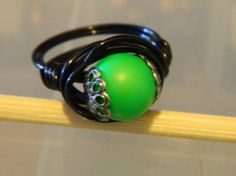 Swarovski Neon Green Pearl Black Coated Copper Wire by uniquenique, $22.00 #onfireteam #lacwe #fest #tbec #ring #jewelry #accessories