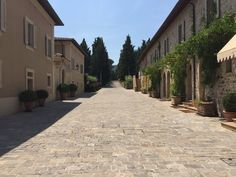 Rosewood Castiglion del Bosco, Montalcino, Italy - Main pedestrian walkway through the property (was originally a small hill-town). This place is so beautiful.