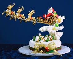Such a cool gravity defying cake = The whole sleigh effect with Santa is just too amazing and he makes it look so easy.