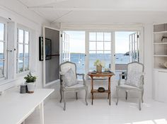 White Sitting Area / Porch ... It's designer and stylist Deb Nelson's dream home. FROM: HOUSE & HOME - East Coast Home