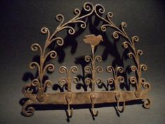 Early forged iron small game or utensils Rack