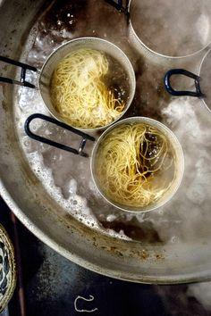 pots of ramen cooking at Bassanova in Chinatown