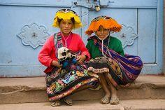 Peru |  Two women in traditional dress photographed at Pisac Market |  © Darrel Gulin