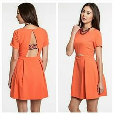 Orange UMGEE dress w/cut outs FINAL PRICE DROP! Umgee dress. Size L. Brand new with out tags (didn't hang right on me) price firm. Been hanging forever, may need to be freshened up but perfect otherwise. Make an offer! Umgee Dresses Mini
