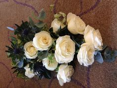 Traditional scottish themed bouquet of thistles, avalanche roses and trailing ivy. Our fave. A x
