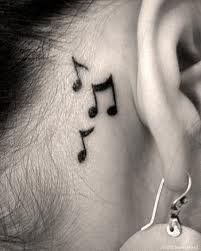 Music notes tattoo behind my ear  Because no matter where I go, I'll always hear the music.