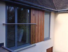 Glass Juliet balcony, cedar cladding, aluminium windows and flat through colour render in Sheffield S10