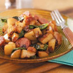 Potato Kielbasa Skillet Recipe Main Dishes with red potato, water, sausages, chopped onion, olive oil, brown sugar, cider vinegar, dijon mustard, dried thyme, pepper, baby spinach, bacon