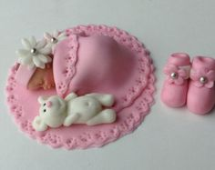 Pink fondant baby shower cake topper. Pink tutu by thecakecart