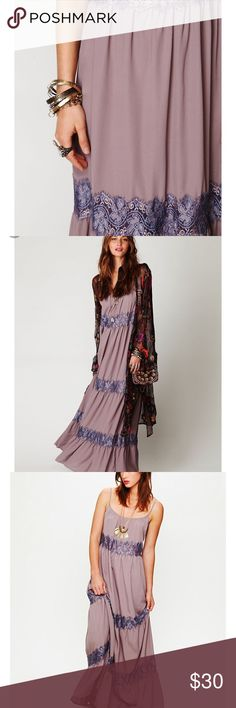 """Free People purple lace stripe maxi dress xs Oversized, fits more like a medium. It's a mauve purple/gray color. Lace stripes. Spaghetti straps and flowy. It's also pretty long. I'm 5'6"""" and I think is best for someone my height or even taller. Lace is sheer. Note: it has a teeny tiny hole on the back. And a few small stains on the front. Price reflects. Because of the sheen to the fabric though they're not very noticeable. Free People Dresses Maxi"""