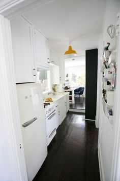 Clever kitchen wall storage + great fridge in this 415-sq-ft cabin in Los Angeles!