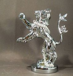 Silver Heraldic Lion Louis Lejeune Ltd. Recent and archive photos of standard and bespoke car mascot/ hood ornament commissions.