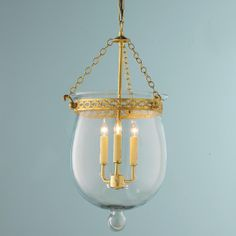 Clear Smokebell Lantern Our quality, classic smokebell lantern is brought to you at a great price. Our exclusively designed smokebell lantern is made with thick hand blown glass, solid brass decorative acanthus band, and three lights for lots of illumination. Choose from Satin Brass or Bronze. Glass is lightly seeded due to hand blown quality.