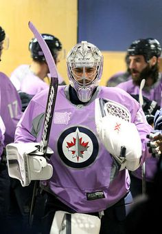 Nov.7 2015 - Flyers 3 - Wpg 0 - Goaltender Ondrej Pavelec #31 of the Winnipeg Jets heads to the ice for the pre-game warm up prior to NHL action against the Philadelphia Flyers at the MTS Centre on November 7, 2015 in Winnipeg, Manitoba, Canada. The Jets sported lavender jerseys and stick tape in honor of Hockey Fights Cancer Night. (Photo by Jonathan Kozub/NHLI via Getty Images)
