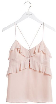 The whimsy is in the details of this pretty pink cami.