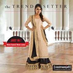 """BLACK & BEIGE JACQUARD KURTA SET. Featuring a beige benarasi jacquard kurta with antique golden piping on its round neck and sleeves. It comes along with a black poly silk sharara bottom with a 4"""" metallic thread embroidered border, golden tissue taping and metallic embroidered lace on the hemline.  The dupatta in free flowing net has golden tissue taping and metallic lace on all four sides. The Price : INR. 2865."""