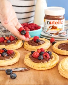 Make something from the 'tart' this #MemorialDay that the whole family will love. First, cut circles out of pastry dough. Bake as directed. Once cooled, spread Nutella® on each pastry and finish off with patriotic-colored berries.
