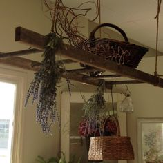 Hang an old ladder as a pot rack