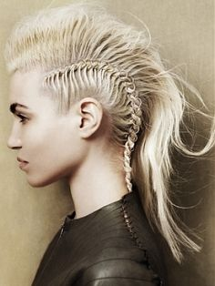 Hairstyle idea. Although I am not too keen on this rather 'punky' hairstyle I do very much like the idea of adding the rings to each new braid element. What do you think?