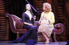 Bebe Neuwirth as Morticia and Carolee Carmello as Alice Beineke in The Addams Family.