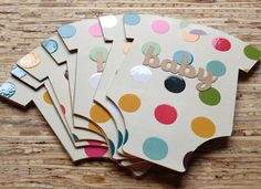 Die-Cut Polka Dot Invites : Fit for a party celebrating a boy or girl, these The Find Sac onesie invites ($4 each) are a unique way to invite guests to a party filled with color.