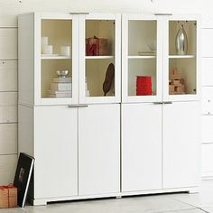 """Everywhere Storage: Versatile modular storage. Solid and engineered wood. Cabinets available with solid or glass doors. Metal handles may be positioned at top or bottom of doors. Bases provide stability; 2-inch lift keeps drawers and doors from scratching floor. Overall product dimensions: 56""""w x 18""""d x 58""""h. $1325"""