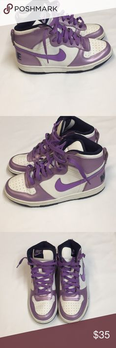 Purple and White Girls 5.5Y Nike High Too Sneakers Purple with Purple Laces and Swoosh Logo. Signs of wear on the shoes and bottoms. Signs are in good condition with much wear still in them. Nike Shoes Sneakers