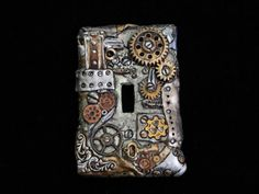 Hey, I found this really awesome Etsy listing at https://www.etsy.com/listing/190400458/steampunk-switch-plate-clay-covered-one