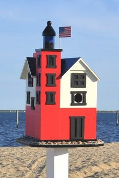 This painted decorative birdhouse is a replica of the lighthouse on Mackinac Island. via Yard Envy