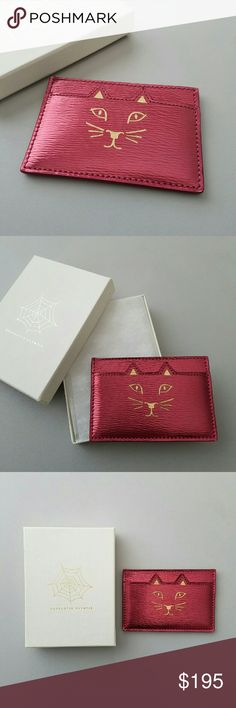 Charlotte Olympia Feline Card Holder Used once for my trip to SF. Like new condition. Authentic. Comes with the box. Color is a red metallic with gold interior. 3 compartments. Contrast-leather lined interior. Made in Italy. Was sold on Shopbop, but is sold out now. Charlotte Olympia Accessories Key & Card Holders