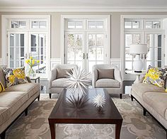 Gorgeous living room... love the doors, rug and accessories!