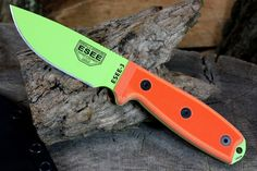 This ESEE-3 fixed blade knife features a venom green finished 1095 steel blade, orange G10 scales and a rounded pommel.