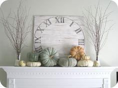 Stacking pumpkins on mantle