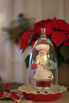 Love this Santa as a table decoration in the red pie plate and cloche