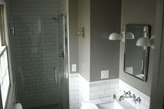 Small bathroom with white subway tiled wall below walls painted in Farrow and Balls Blue Gray.