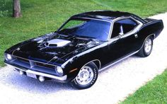 1970 Plymouth 'Cuda -- beautiful black with a silver Shaker scoop and Rallye wheels ... ALL factory!!