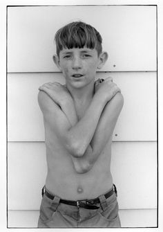 Boy standing with arms crossed.. From Duke Digital Collections. Collection: William Gedney Photographs and Writings.