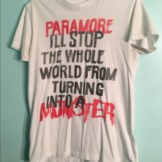 Paramore Monster Shirt Worn a lot but, still in good condition. Unisex. Size may range from M to L. Paramore tee includes lyrics from Monster. Any questions, feel free to comment. Hot Topic Tops Tees - Short Sleeve