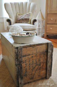 Enamel pan on living room trunk.  Like the chair in the background, looks comfy.