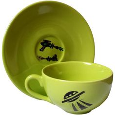 This alien inspired green ceramic teacup was designed by @FeliciaAnneKing. This duo designed cup features an alien spaceship ready to beam up the unsuspecting on one side, while the other hosts a wide-eyed alien. Twin laser guns zap and pew on the center of the saucer making this the perfect gift for those believing we are not alone in the verse. Alien Spaceship, Teacup, Twin, Artisan, Guns, Ceramics, Inspired, Green, Artwork