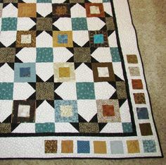 A variation of the Hip to Be Square quilt. Instead of a Kansas dug-out alternate block, she put half-square triangles on just one side of the square. This makes the large solid block into a star!