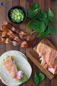 Salmon, Guacamole, and Bacon Wraps - An easy meal with salmon, guacamole, and bacon all wrapped up in a warm tortilla. | tamingofthespoon.com