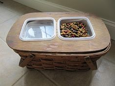 elevated dog bowls out of an old picnic basket and you can lift the food bowl out to get to the dog food underneath in the basket. So freakin clever.