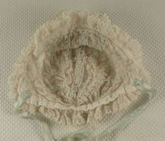 Marvelous French antique all original Valenciennes lace and aqua silk ribbon bonnet from the 1890's.  Wonderful decoration on the front of narrow