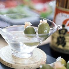 Sake Martinis  Sake replaces gin in this nontraditional martini. Pickled-ginger stuffed green olives make a pretty garnish.
