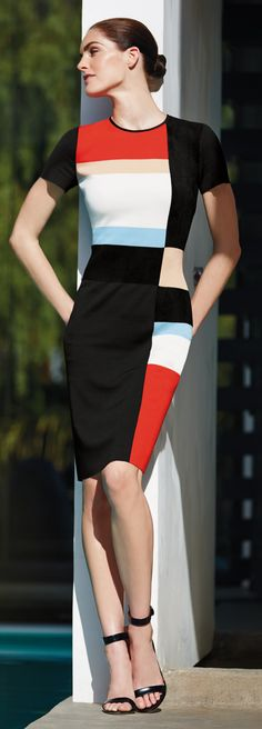 Be bold with your look in this #StJohnKnits graphic color blocking modernized classic sheath dress from the PreFall 2015 collection.   sjk.com