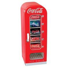 """+ Design de produto :     Que tal ter uma mini máquina de refrigerante? É a idéia do """"Koolatron vending fridge"""", que suporta até 10 latinhas e mantém elas geladas."""