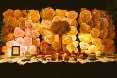 Even the backdrop for a charcuterie station at Seth MacFarlanes Oscars event was given a dramatic look with a wall of paper flowers.